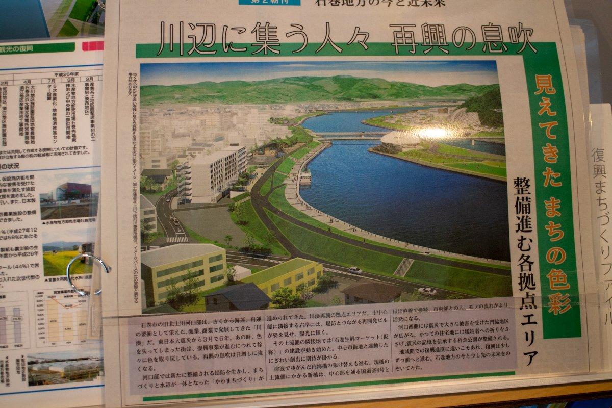 Am Flussufer entstehen ein großer neuer Deich und Wohngebäude.